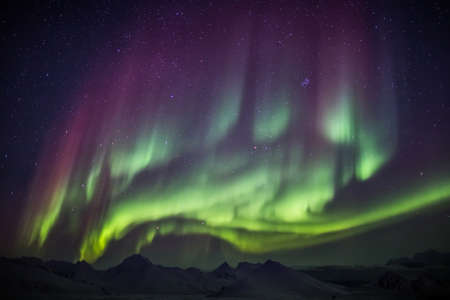 arctic landscape: Arctic landscape with Northern Lights - Spitsbergen, Svalbard Stock Photo