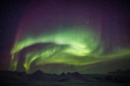 svalbard: Arctic landscape with Northern Lights - Spitsbergen, Svalbard Stock Photo