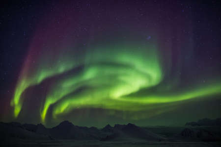 magnetic field: Natural phenomenon of Northern Lights (Aurora Borealis) related to the earths magnetic field, ionosphere and solar activity. Solar storm. Stock Photo