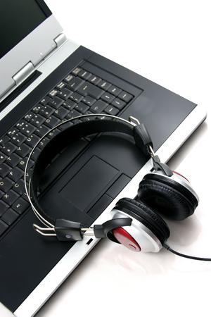 Laptop, headphones Stock Photo