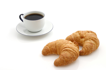 Croissant, cup of coffee photo