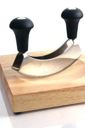 mincing: Mincing knife with wooden board