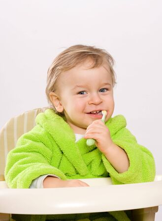 Little boy (two years) brushing teeth
