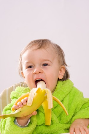 eating banana: happy baby eating banana