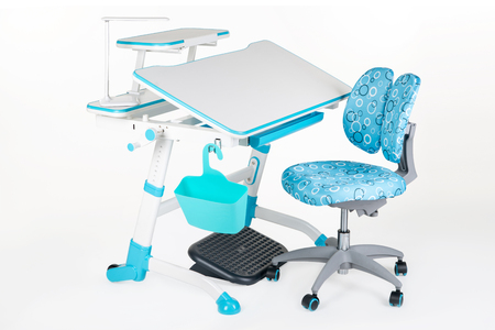 Blue chair, school table, blue basket, desk lamp and black support under legs on the white isolated background.