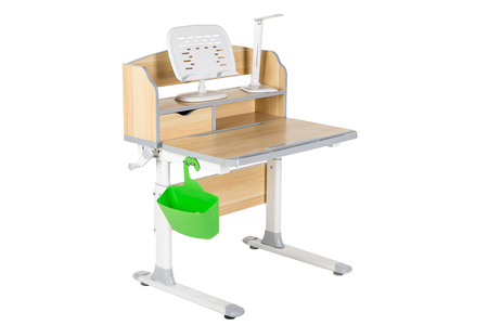 schooldesk: Wooden school table, green basket and desk lamp on the white isolated background.