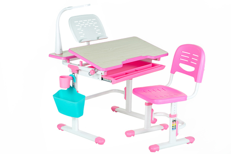 Pink chair, pink school table, blue basket and desk lamp on the white isolated background.