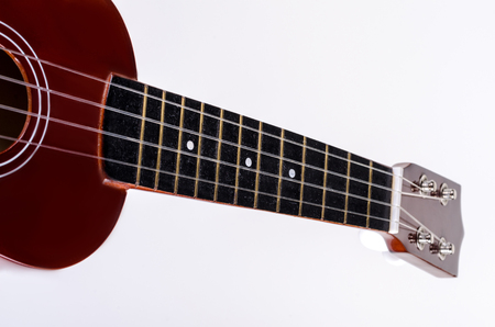 caoba: Modern Hawaiian guitar with four strings on a white background isolated