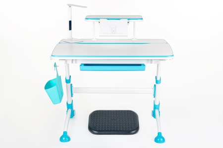 schooldesk: Blue school table, blue basket, desk lamp and black support under legs on the white isolated background. Stock Photo