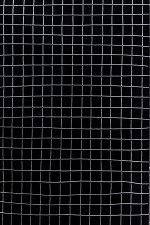 rupture: metal grid on a black background on the entire frame
