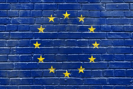 stability: brick wall with the image of the flag of the European Union