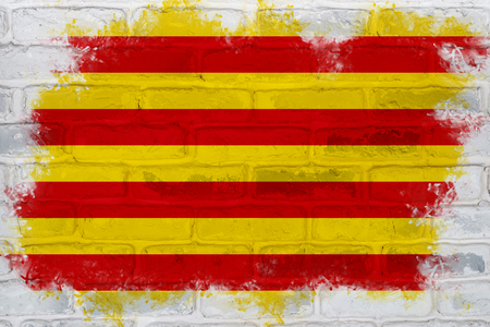 Flag of Catalonia painted on a brick wall