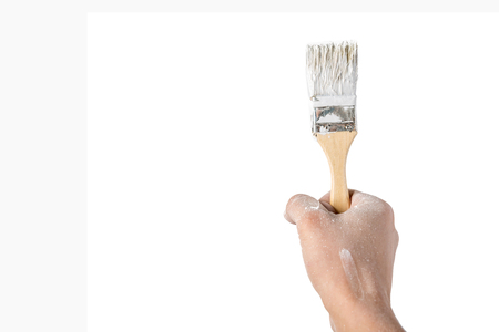 hand with a brush on white isolated background