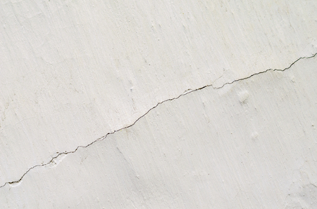 texture white shabby paint with a crack on the whole frame Stock Photo