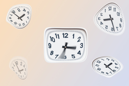 several curved white clock on isolated background Stock Photo