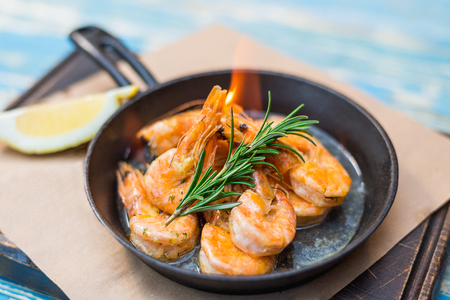 shrimp with fire in a frying pan Stock Photo