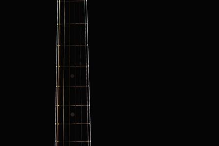 guitar neck on a black background