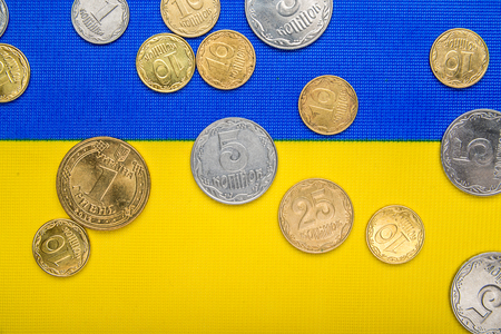 Ukrainian national coins against the background of the national flag. Eurovision currency