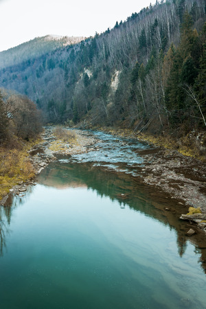 view of the river or lake surrounded by mountains and stones Stockfoto - 116150413