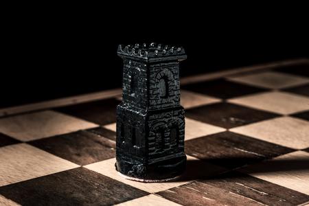 Chess board. Beautiful black handmade rook. Horizontal frame Zdjęcie Seryjne