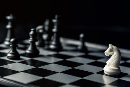 Chess board. White horse threatens black opponents chess. Horizontal frame