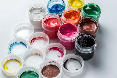 small cans of colorful gouache paint on the whole frame. Horizontal frame Standard-Bild - 116154726