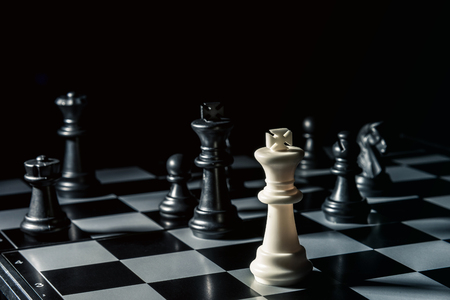 Chess board. White king threatens black opponents chess. Horizontal frame