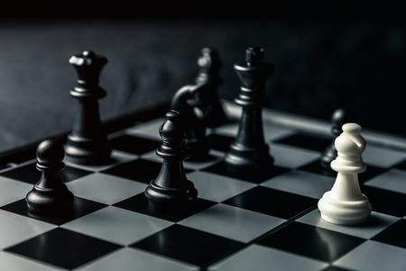 Chess board. White Elephant threatens black opponent's chess. Horizontal frame