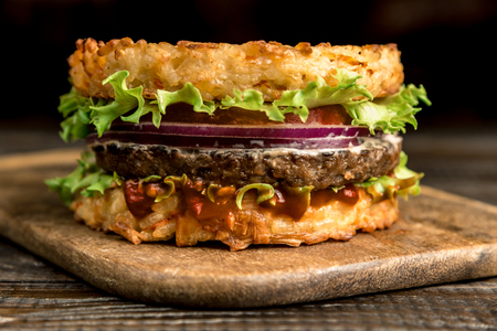 Healthy lifestyle, proper nutrition. Healthy rice burger with vegetables, herbs and cutlet. Horizontal frame Stockfoto - 116155658
