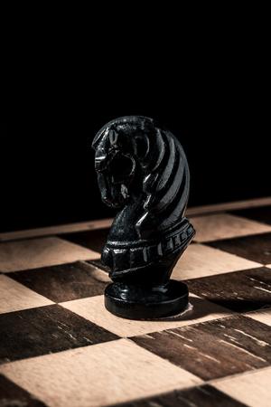Chess board. Beautiful handmade black horse. Vertical frame