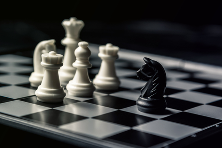 Chess board. The black horse threatens the opponents white chess. Horizontal frame