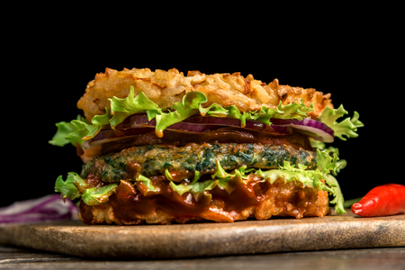 Healthy lifestyle, proper nutrition. Healthy rice burger with vegetables, herbs and cutlet. Horizontal frame