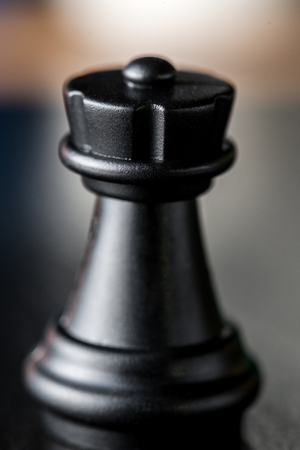 black chess rook closeup on blurred background. Vertical frame Stock Photo
