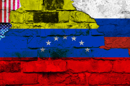 Flag of Venezuela, Russia and the USA on a brick wall background with broken plaster. Horizontal frame