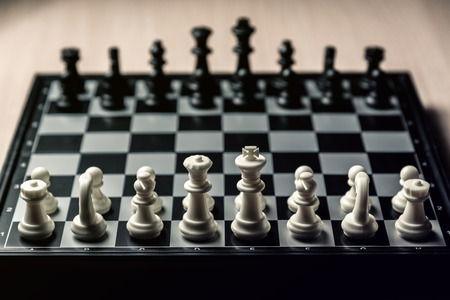 Chess board with black and white chess facing each other. Horizontal frame