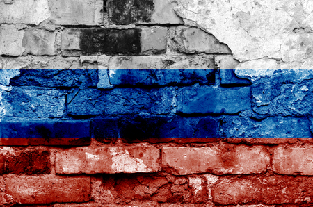 Russia flag on a brick wall background with broken plaster. Horizontal frame Standard-Bild