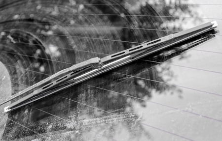 Dirty car window with a wiper blade. Horizontal frame Stock Photo