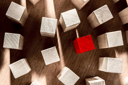 Risk and strategy in business, a lot of wooden blocks with red in the middle. Horizontal frame