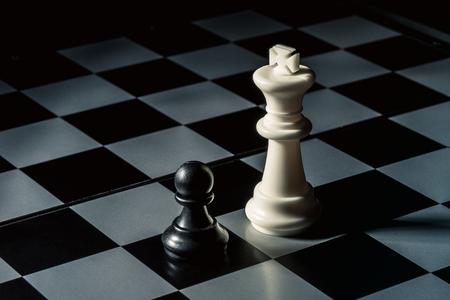 Chess board. White king threatens black opponent's pawn. Horizontal frame Stok Fotoğraf - 117311869