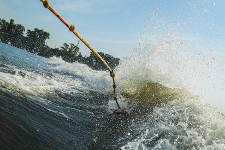 Fall for riding a wakeboard on the background of a big wave. Horizontal frame Stock Photo