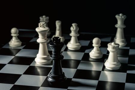 Chess board. Black king threatens white opponents chess. Horizontal frame