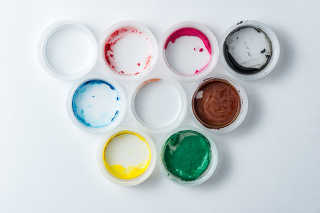 small cans of colorful gouache paint on the whole frame. Horizontal frame Standard-Bild - 120115210