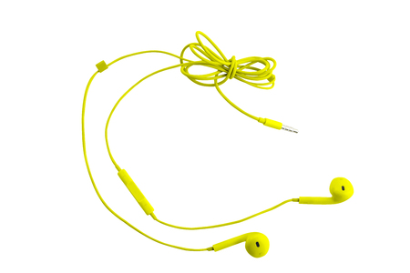 Beautiful yellow headphones for smartphones, tablets, music players and a computer with a headset, on a white isolated background. Horizontal frame Reklamní fotografie - 120213506