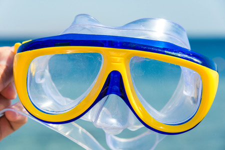 yellow-blue mask and snorkel for the whole frame. Horizontal frame
