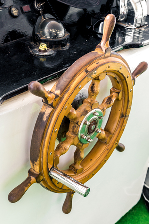 modern small wooden steering wheel on the ship