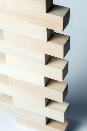 abstract geometric figure from wooden cubes, on an uneven white background