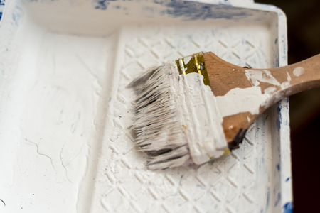 dirty brush with white paint is on the stand Standard-Bild - 120373058