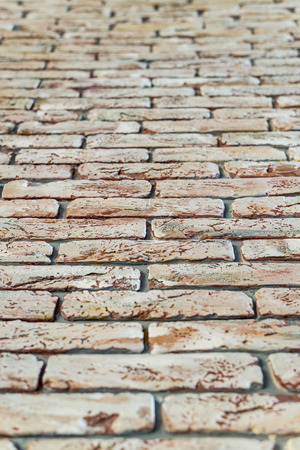 red brick wall texture grunge background with vignetted corners, may use to interior design. Vertical frame
