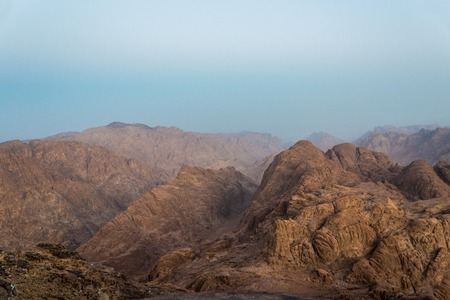 Middle East or Africa, picturesque bare mountain range and a large sandy valley desert landscapes landscape photography. Horizontal frame