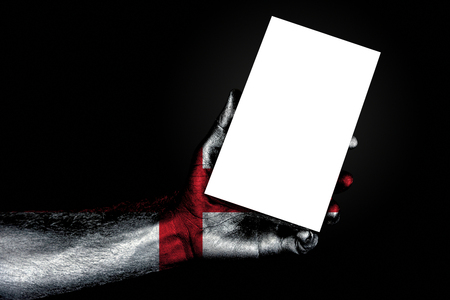 hand with painted flag England holding a large white sheet with space for an inscription, mock up. Horizontal frame